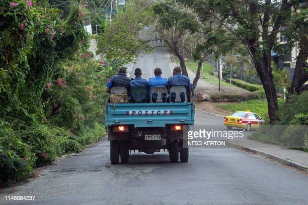 Police commute on a road as the close streets leading to Parliament house in Port Moresby on May 28 2019 Papua New Guinea Prime Minister Peter...
