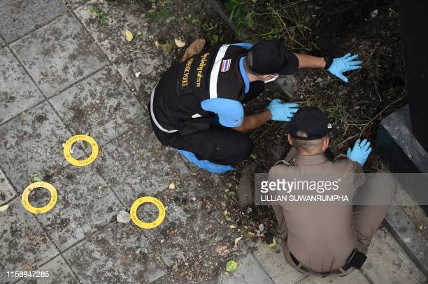 Police conduct an investigation at the scene of an explosion in Bangkok on August 2 2019 At least two small bombs exploded in Bangkok on August 2...