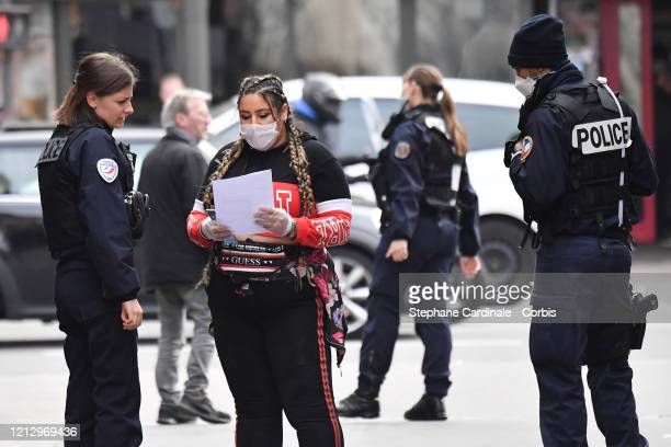 Police conduct checks on members of the public on March on 17 while a strict lockdown comes into in effect in France to stop the spread of COVID19...