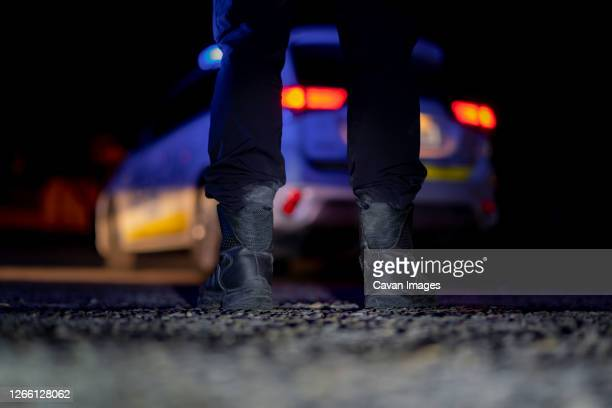 police conducting checks at night - terrorism stock pictures, royalty-free photos & images