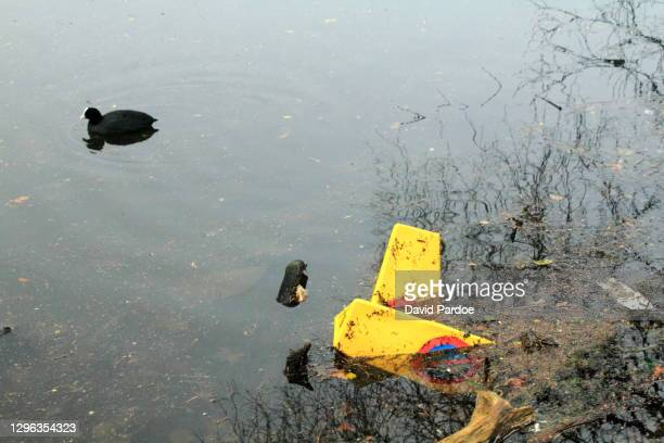 police cones dumped in a lake - south wales stock pictures, royalty-free photos & images