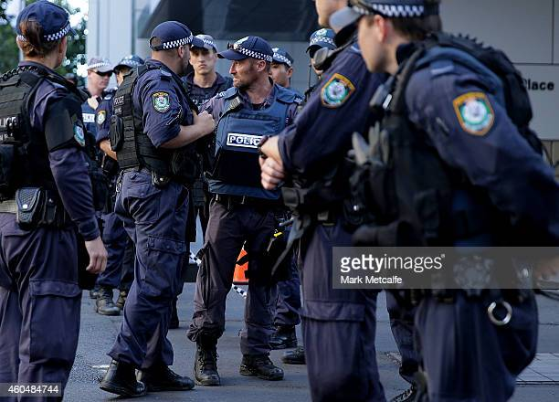 Police confer on Philip St near the Lindt Cafe Martin Place on December 15 2014 in Sydney Australia Police attend a hostage situation at Lindt Cafe...