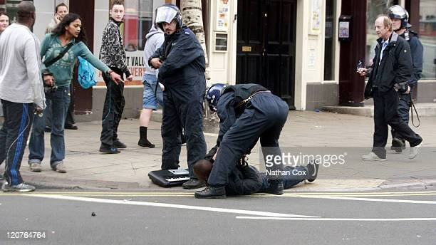 Police confront a man in Manchester City Centre on August 9 2011 in Manchester England After three nights of rioting and looting in and around London...