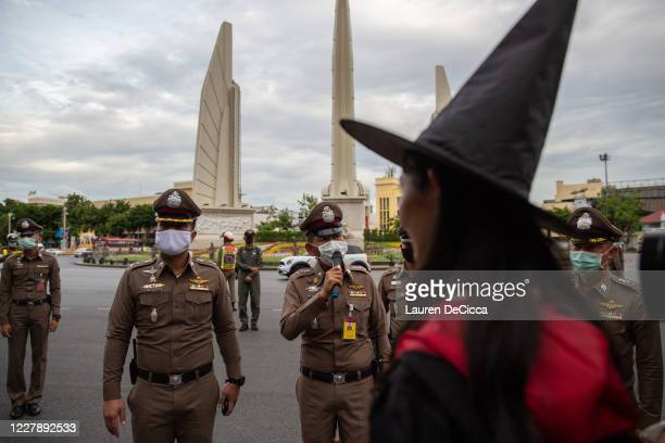 Police confront antigovernment protesters as they take part in a Harry Potter themed rally in front of Democracy Monument on August 3 2020 in Bangkok...