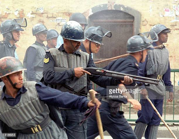 Police confront demonstrators after the announcement of the death of King Dipendra and the coronation of his uncle King Gyanendra June 4 2001 in...