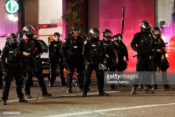 Police confront demonstrators as Black Lives Matter supporters demonstrate in Portland, Oregon on July 4, 2020 for the thirty-eighth day in a row at...
