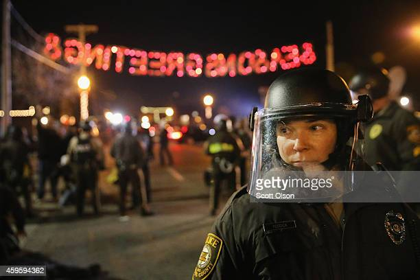 Police confront demonstrators during a protest on November 25 2014 in Ferguson Missouri Yesterday protesting turned into rioting following the grand...