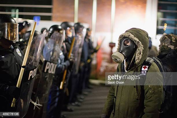 Police confront demonstrators protesting the shooting death of 18-year-old Michael Brown outside the police station on November 19, 2014 in Ferguson,...