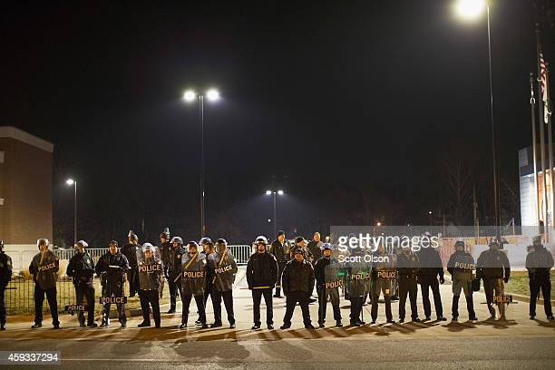 Police confront demonstrators protesting the shooting death of 18yearold Michael Brown outside the police station on November 20 2014 in Ferguson...