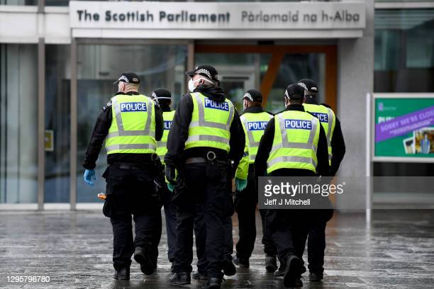 Police confront Members of The Scotland Against Lockdown group as they attempted to protest outside the Scottish Parliament on January 11, 2021 in...