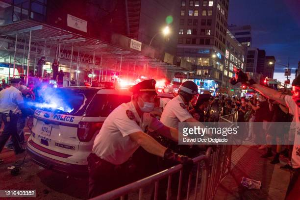 Police confront protesters in Union Square on May 30 2020 in New York City Minneapolis Police officer Derek Chauvin was filmed kneeling on George...