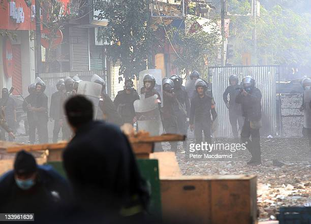 Police confront protestors near Tahrir Square on November 23 2011 in Cairo Egypt Thousands of Egyptians are continuing to occupy Tahrir Square after...