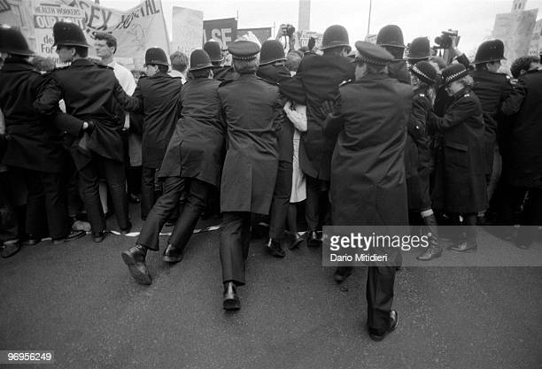 Police confronting demonstrators during a NHS strike organized to protest against cuts in funding proposed by the Thatcher's government London UK 1984
