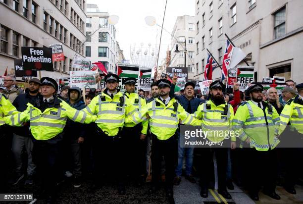Police contain a ProPalestinian national march against a counter Israeli demo through central London England on November 4 2017 as pro Palestinians...