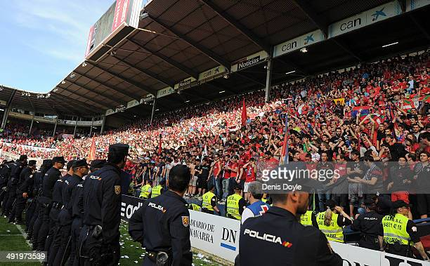 Police contain spectators after a barrier collapsed during the La Liga match between CA Osasuna and Real Betis Balompie at Estadio Reyno de Navarra...