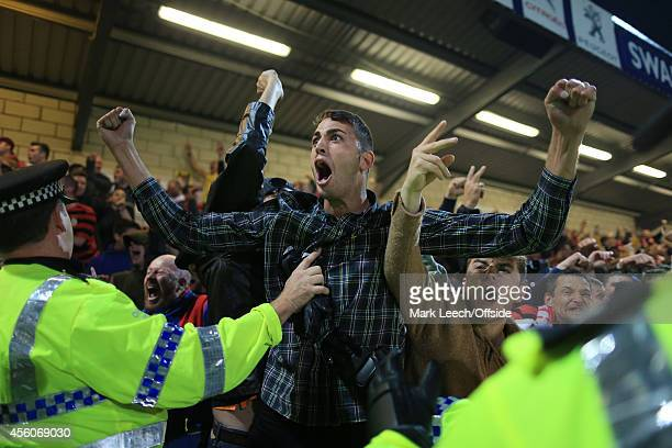 Police contain the Wrexham fans during the Vanarama Conference match between Chester and Wrexham at the Deva Stadium on September 22, 2014 in...