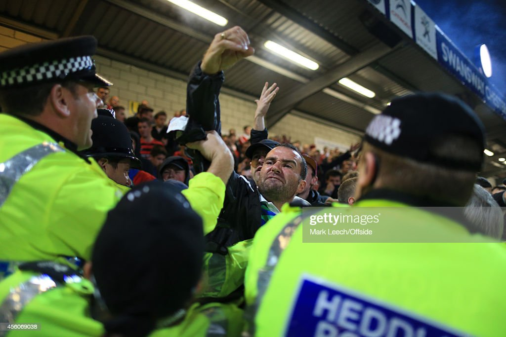Police contain the Wrexham fans during the Vanarama Conference match between Chester and Wrexham at the Deva Stadium on September 22, 2014 in Chester, England.
