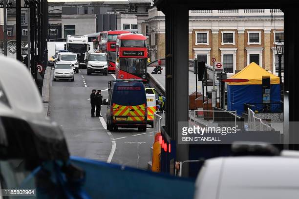 Police continue work on London Bridge in the City of London on December 1 following the November 29 deadly terror incident Britain's Boris Johnson...
