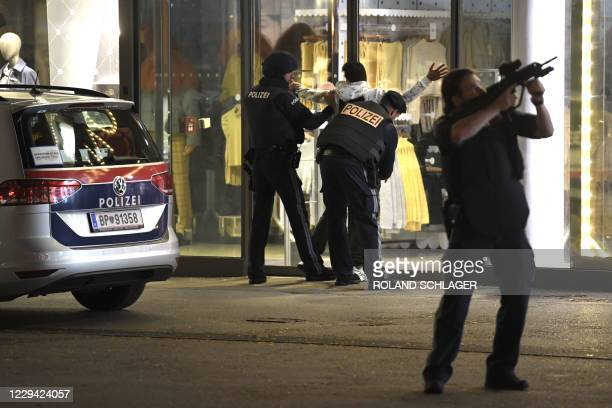 Police control a person as they patrol in central Vienna on November 2 following a shooting near a synagogue. - Austrian Interior Minster Nehammer...
