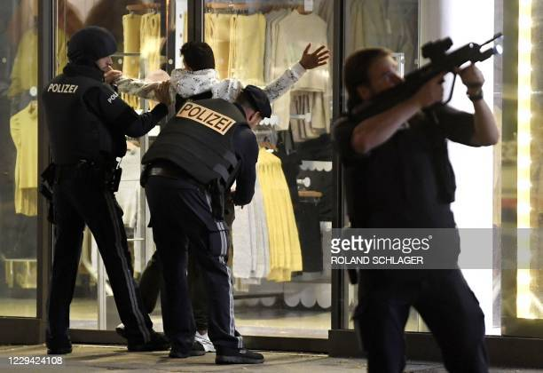 Police control a person at Mariahilferstrasse in central Vienna on November 2 following a shooting near a synagogue. - Austrian Interior Minster...