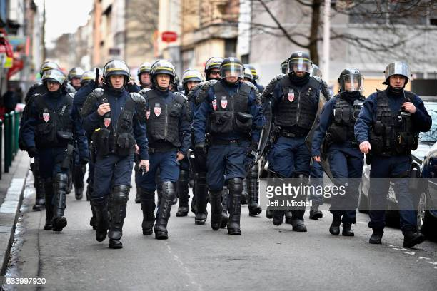 Police control anti establishment demonstrators in Place Raspail while the National Front Leader Marine Le Pen holds her presidential campaign launch...