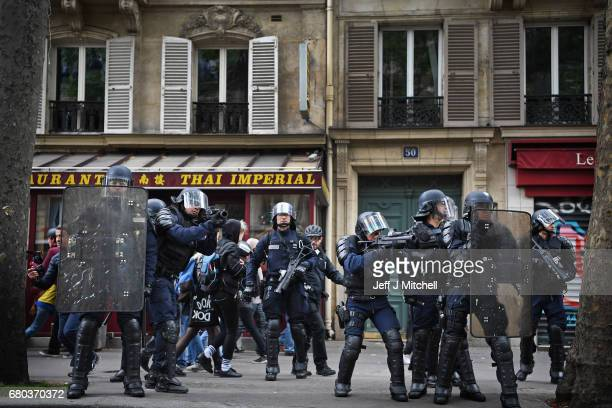 Police control demonstrators on a trade unions demonstrations against the election of Emmanuel Marcon on May 8 2017 in Paris France The centrist...