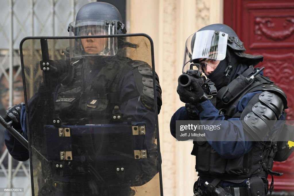 Police control demonstrators on a trade unions demonstrations against the election of Emmanuel Marcon on May 8, 2017 in Paris, France. The centrist candidate Mr Marcon defeated far right candidate Marine le Pen in yesterday's run off for the French presidency.