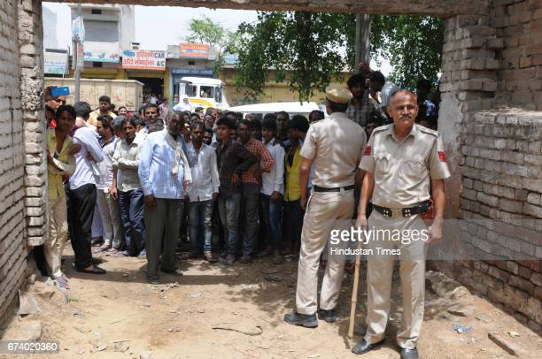 Police control the people after a leopard entered a house in Durga colony of Sohna on April 27 2017 some 25 km from Gurgaon India