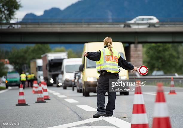 Police control traffic at the German Austrian border on September 14 2015 near Bad Reichenhall Germany Germany has temporarily introduced controls...