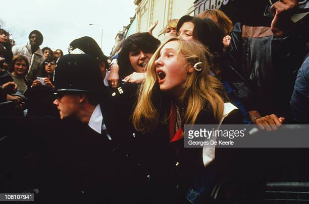 Police controlling a crowd of Michael Jackson fans outside Madame Tussauds wax museum London 28th March 1985 The star is due to unveil a new likeness...