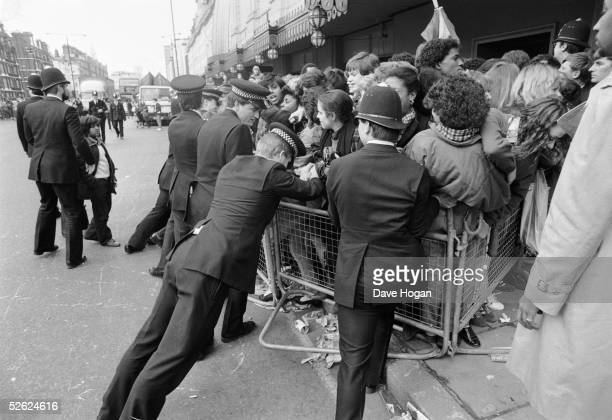 Police controlling a crowd of Michael Jackson fans outside Madame Tussauds wax museum London 3rd March 1985 The star is due to unveil a new likeness...