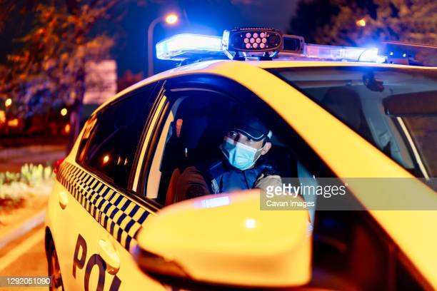 police controlling the city confined by covid19 - madrid stock pictures, royalty-free photos & images