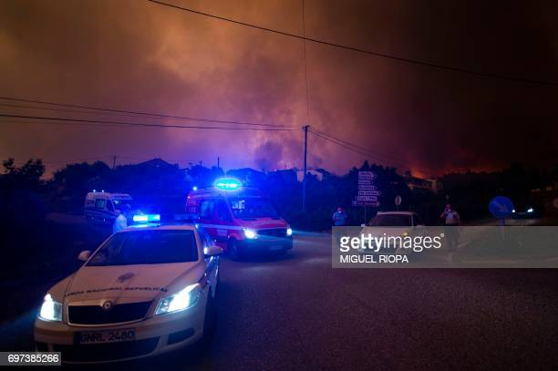 Police controls the traffic during a wildfire in the village of Derreada Cimeira on June 18 2017 Portugal declared three days of national mourning...