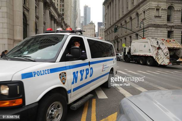 Police converge in lower Manhattan following the discovery of a pressure cooker left on the sidewalk on February 1 2018 in New York City The pressure...