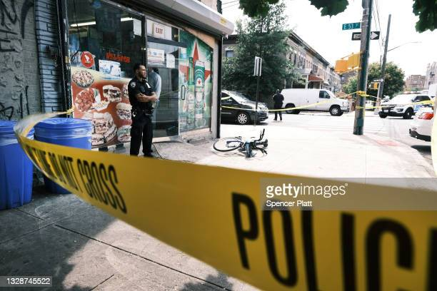 Police converge on the scene of a shooting in Brooklyn, one of numerous during the day, on July 14, 2021 in New York City. New York Governor Andrew...