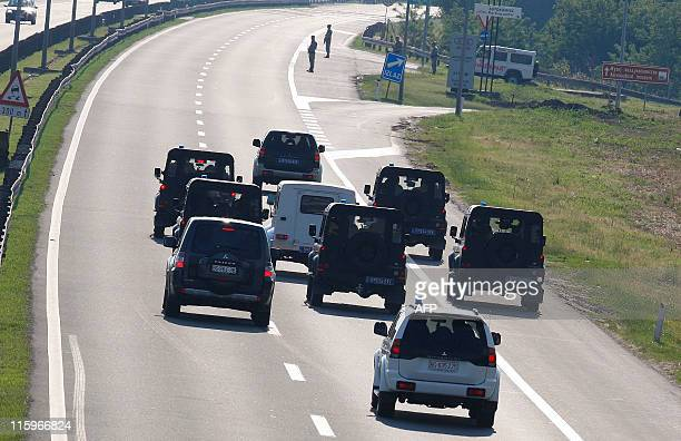 A police convoy allegedly caring Ratko Mladic approaches Belgrade airport on May 31 2011 Serbia on Tuesday sent Bosnian Serb exarmy chief Ratko...
