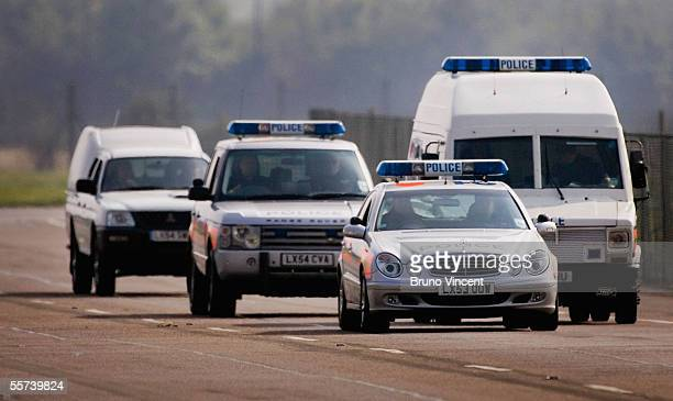 A police convoy carrying suspected failed bomber Hussain Osman leaves RAF Northolt airfield September 22 2005 in London England The suspect from the...