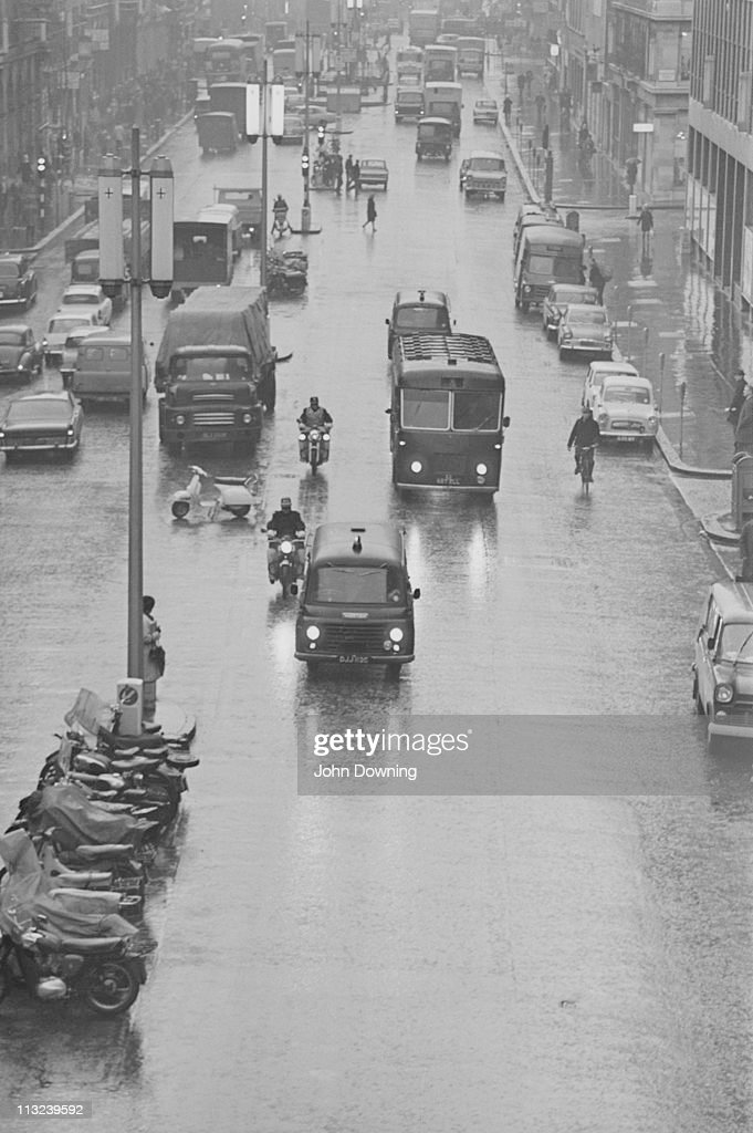 A police convoy takes the Kray Twins to the Old Bailey in London at the start of their trial, 7th January 1969. Brothers Ronnie and Reggie Kray were found guilty of murder in March 1969, and sentenced to life imprisonment.