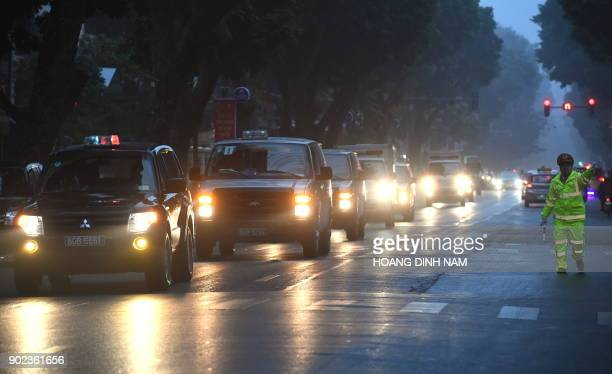 A police convoy transporting defendants including Trinh Xuan Thanh a former oil tycoon who was reportedly kidnapped from Berlin by Vietnamese...