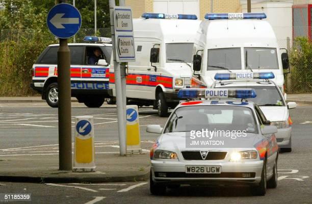 Police convoy transporting eight men arrested in antiterrorist raids 03 August arrivees in an armoured van at Belmarsh Magistrates Court 18 August...