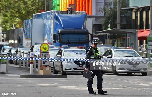 Police corden off Bourke Street after a car ploughed into pedestrians in the centre of Melbourne on January 20 2017 Three people died and 20 others...