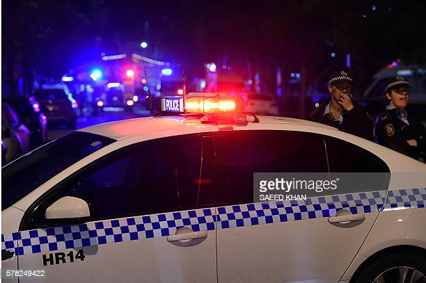 Police corden off the area around a police station in the Merrylands neighbourhood area of Sydney on July 21 2016 A man was arrested in Sydney on...
