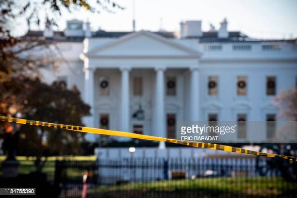 A police cordon is seen blocking the access at the White House in Washington DC on November 26 during a lockdown started following an air space...