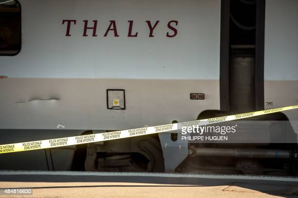 A police cordon is setup along the platform next to a Thalys train of French national railway operator SNCF at the main train station in Arras...