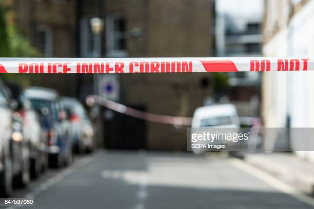 Police cordon is tied round a local street sign at Parsons Green Underground Station Emergency services are investigating reports of an explosion at...