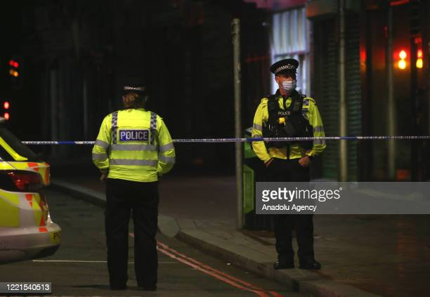 Police cordon near the scene where three people have died and three more have been seriously injured following stabbings in Forbury Gardens, Reading,...