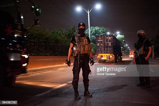 Police cordon off a crime scene of a shootout which killed two unidentified gunmen on August 19 2016 in Manila Philippines The death toll from the...