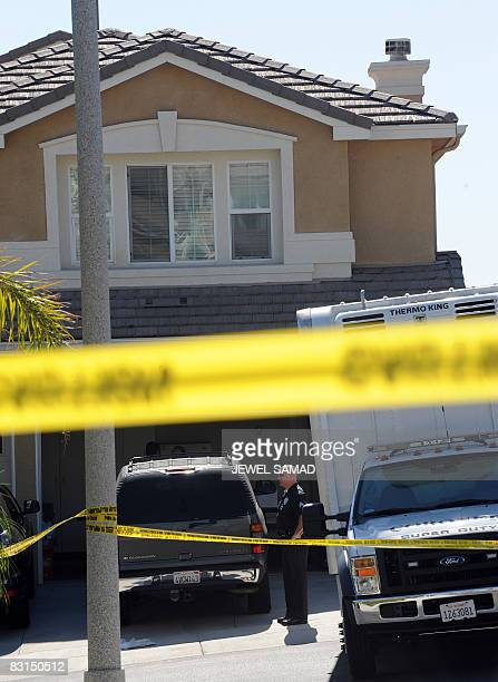 Police cordon off a house where a jobless man shot and killed his family in Los Angeles on October 6 2008 The 45yearold unemployed California man...