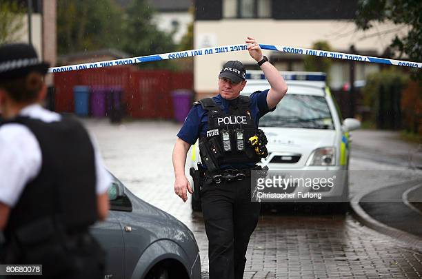 Police cordon off a road in Croxteth following 12 arrests in connection with murder of 11yearold schoolboy Rhys Jones April 15 2008 in Liverpool...