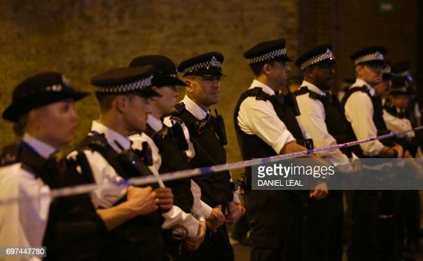 TOPSHOT Police cordon off a street in the Finsbury Park area of north London after a vehichle hit pedestrians on June 19 2017 One person has been...